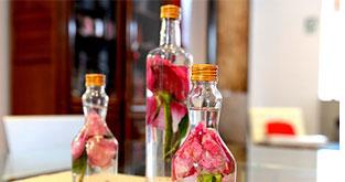 Centro de mesa botellas con flores